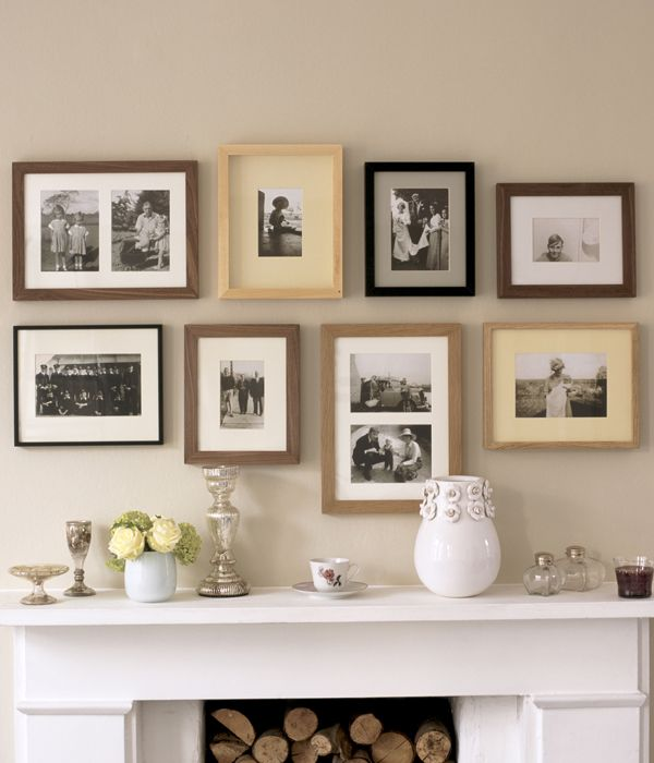 Photo wall with eclectic frames; like it better than same frames.