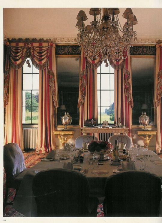 Dramatic red-and-white striped curtains in the dining room at Badminton House.