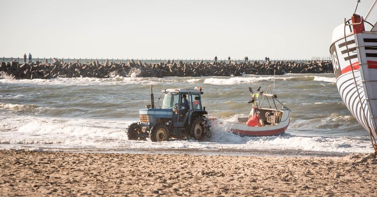 https://flic.kr/p/yzUWgX | Pushing | In Nr. Vorupør the fishing boats are drawn on land, and again pushed into the water by a tractor.