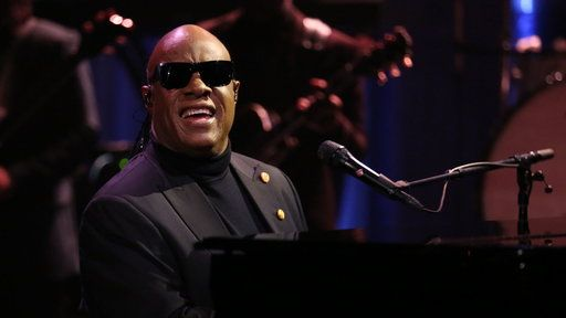 """Watch The Tonight Show Starring Jimmy Fallon Season 4 Episode 65 Excerpt Free Online - Stevie Wonder Sings """"Isn't She Lovely""""/""""My Cherie Amour"""" to Michelle Obama 