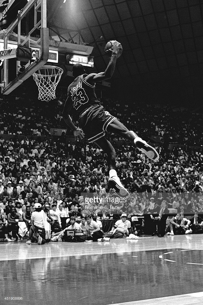 Michael Jordan #23 of the Chicago Bulls attempts a dunk during the 1987 Slam Dunk Contest on February 7, 1987 at Seattle Center Coliseum in Seattle, Washington.