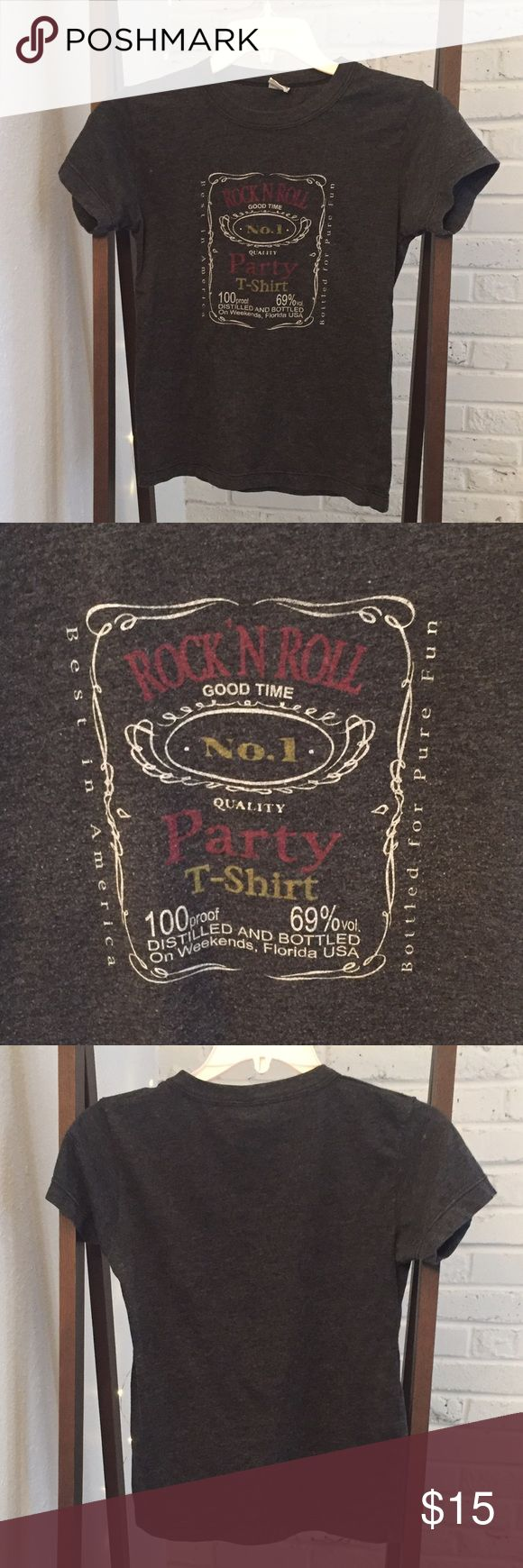 "Urban Outfitters Rock n Roll Jack Daniels T-Shirt Urban Outfitters soft ""party"" jack Daniels looking tshirt. No flaws; pre-loved condition. I'm a true medium, but it's tight on me so I'm listing as a small. However, it could go from XS-M depending on how you like to wear shirts! Urban Outfitters Tops Tees - Short Sleeve"