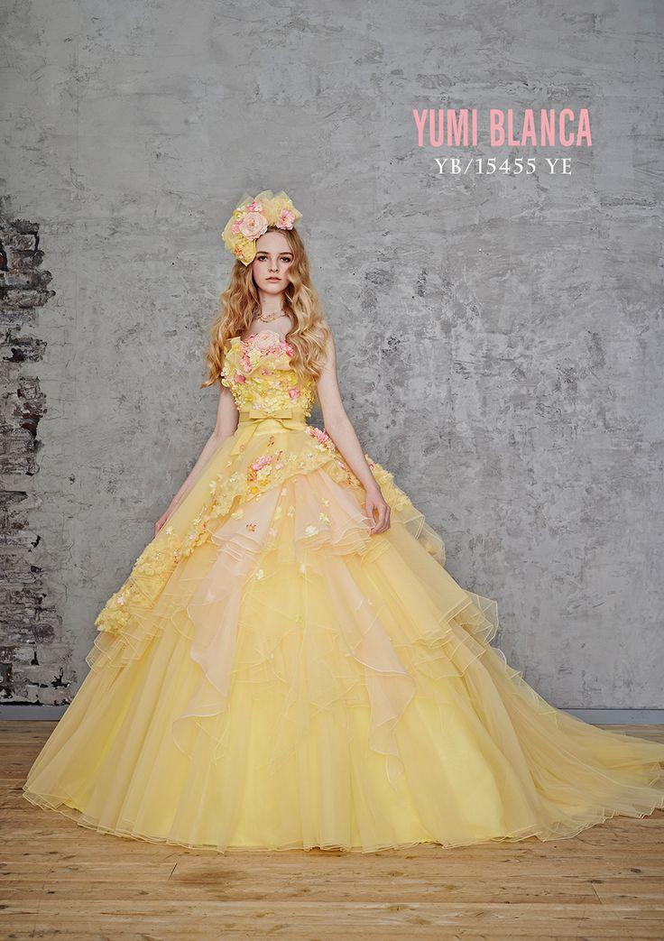 YB-15455YE - 桂由美 カラードレス - 優しいイエローにラブリーなピンクの小花をあしらったキュートなカラードレス。 アシンメトリーに流れるフリンジがドレスのボリュームをエレガントにもプリティーにも表現できるのも頼もしい1着です。 ブーケにもベビーピンクなどの優しいカラーコーデでより一層ロマンティックに! 主に春~夏婚の花嫁に人気ですが、会場の雰囲気