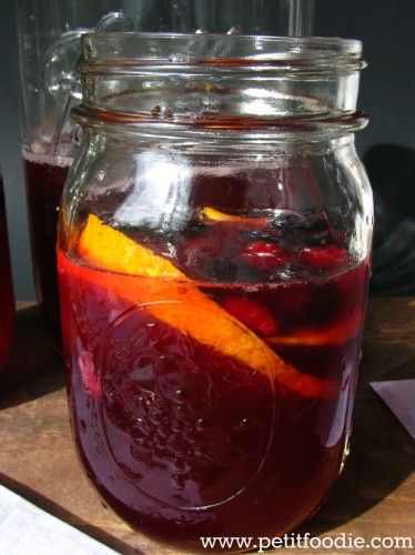 summer sangria - super refreshing. Used Barefoot Red Moscato. Double recipe and add some more pineapple juice to make a gallon.