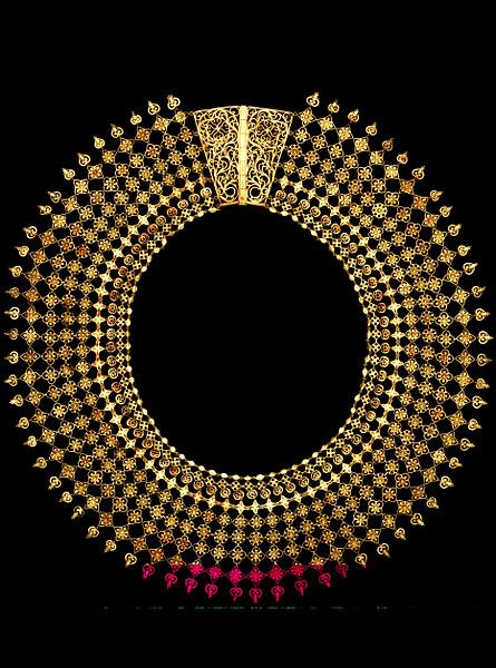 """This gold necklace was one of the earliest Indian objects bought for what would become the Victoria and Albert Museum. It was exhibited at the 1851 Great Exhibition as """"modern"""" work from Calicut, and was bought for a considerable sum for the new South Kensington Museum as an example of the best international contemporary design."""