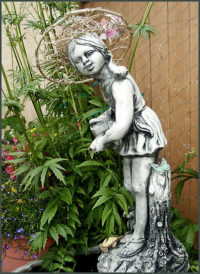 My garden girl wearing a willow hat. by Sandra Foster ©