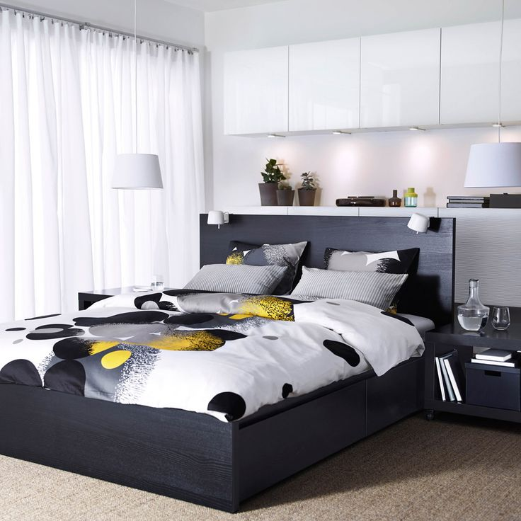 A Bedroom With Black Brown Malm Bed BestÅ Storage White Doors And