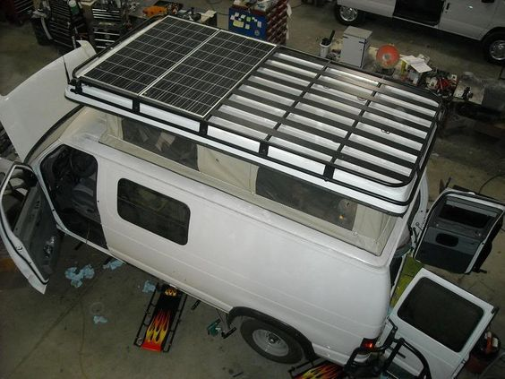 Aluminess roof rack installation on a Ford van with pop top