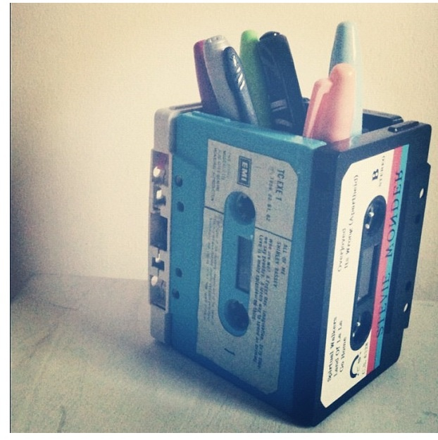 Cute upcyled pencil holder made out of old cassette tapes! Just glue together and cut cardboard to fit bottom.
