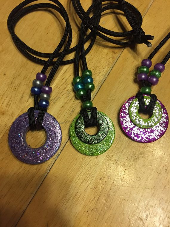 Necklace made out of washer. Painted, sparkles added and a clear coat on top. Black parachute cord used for necklace part.
