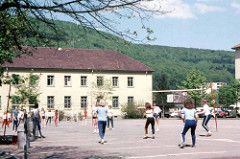 Lahr Secondary gym class on the Casern and K9 administration building 1978 (D70) Tags: black game west slr net film forest 35mm canon germany education scanner background teenagers olympus canadian class 35mmfilm frame half scanned take volleyball secondary schools pe gym quadrangle schwarzwald defense zuiko department canoscan forces k9 dnd lahr physical armed intermediate f35 caserne autozoom casern olympuspenf 8600f 50–90mm zuikoautozoom50–90mmf35 70–130mm