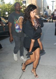 Kanye West Carries Son with Kim Kardashian And Daughter Wearing Tupac T-Shirt…