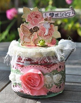 An altered candy jar using Once Upon A Springtime papers.