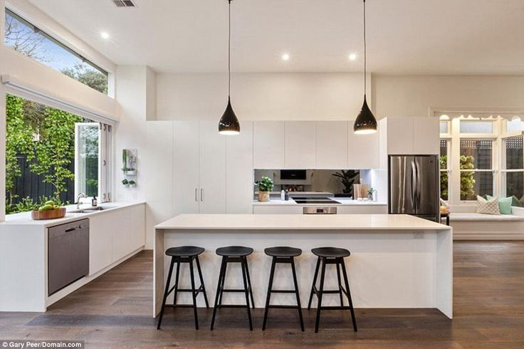 Home: A gleaming white kitchen boasts a breakfast bar in the property where Sam…