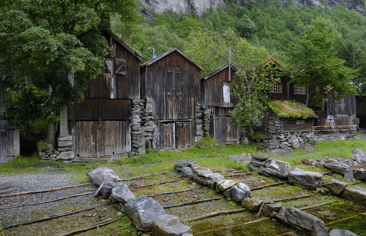Old boathouses in Geiranger, Norway by Bård Larsen