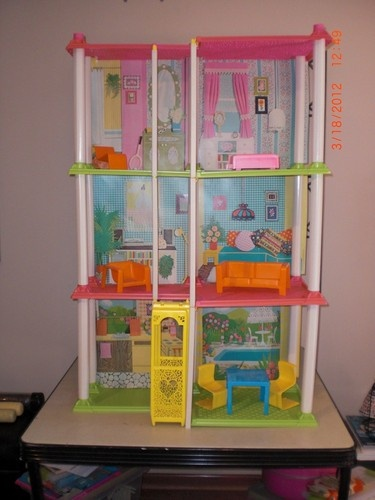 Barbie Townhouse :o) When I was little, I had 2 of these cause my sister hated Barbie but we both got one...My  Barbie's were Ballin'!!