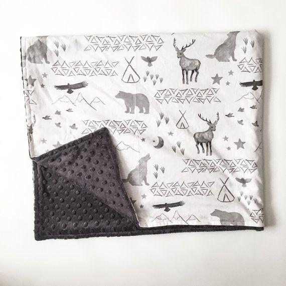 These blankets measure approximately 36 X 42, and are made with a nice, 100% cotton print on one side and your choice of minky or solid cotton on the