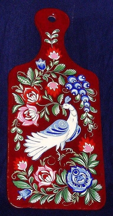 A wooden chopping board with folk Gorodets painting from Russia. #art #folk…