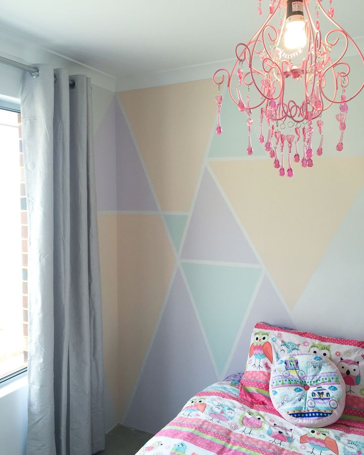 Kids bedroom feature wall  pastel triangles and a chandelier