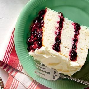 Our Best Christmas Cakes | White Cake with Cranberry Filling and Orange Buttercream  | MyRecipes.com