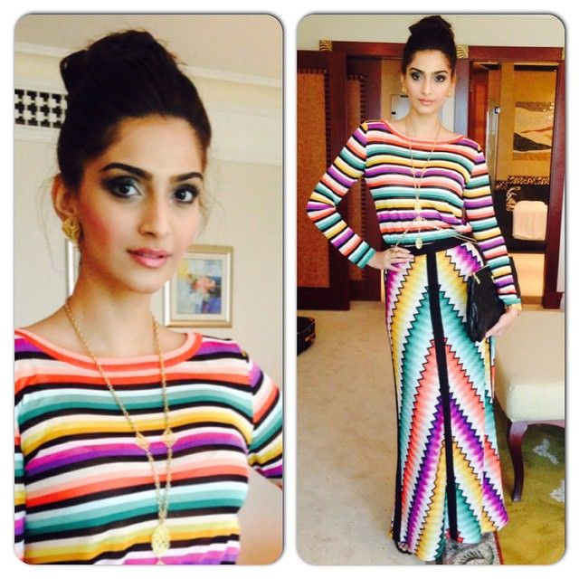Sonam Kapoor in a colourful rainbow dress. Love her makeup and hairbun. Indian Bollywood fashion.