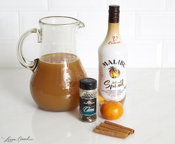 Spiced & Spiked Cider  8 cups apple cider  1 bottle Malibu Island Spiced Rum (1 shot per each serving)  1 teaspoon whole cloves  8 cinnamon sticks  2 oranges, sliced