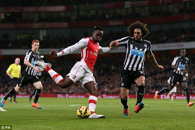 Fabricio Coloccini (right) made some key tackles but struggled to cope with the pace of Ar...