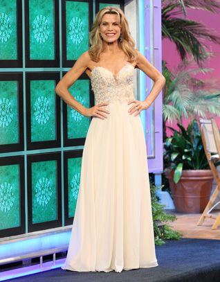FAVIANA: Champagne gown w/re-embroidered lace bodice enhanced with silver rhinestones, strapless, multi-tier chiffon full skirt  | Vanna White's dresses | Wheel of Fortune