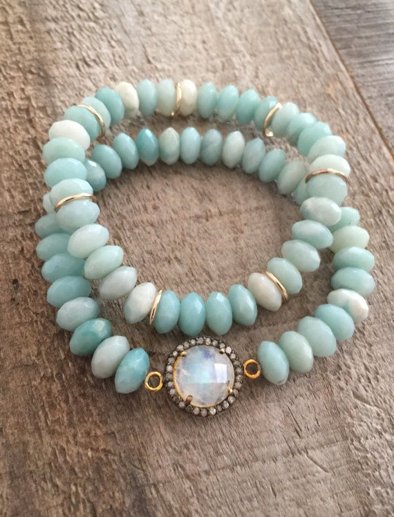 Glowing moonstone is encircled with raw pave diamonds and adorned with pale blue-green amazonite beads along this set of stretch bracelets. Faceted moonstone boasts beautiful rainbow flash. It is bezel set in gold vermeil and encircled with raw pave diamonds. The tiny diamonds are