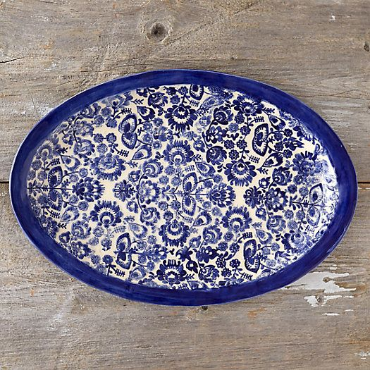 Imprinted with a Scandinavian folk pattern of delicate flowers, this textured serving platter makes a beautiful addition to the table. From The Potter & Woodsmith, each platter is pressed and glazed completely by hand for one-of-a-kind appeal.