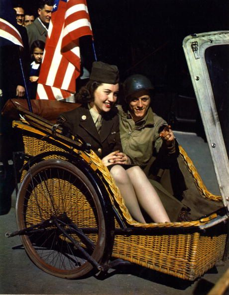 Portrait of American Corporal Ruth Quinby and Corporal William Zamieszcy as they sit together in a bicycle taxi, Paris, France, 1945. (Photo by PhotoQuest/Getty Images)