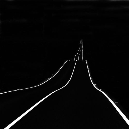 I love how three simple lines on a black background can create such a eerie mood and accurately depict a road.