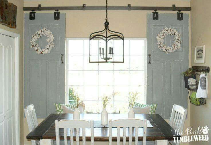 Such a neat idea for old vintage antique doors..barn door window treatment