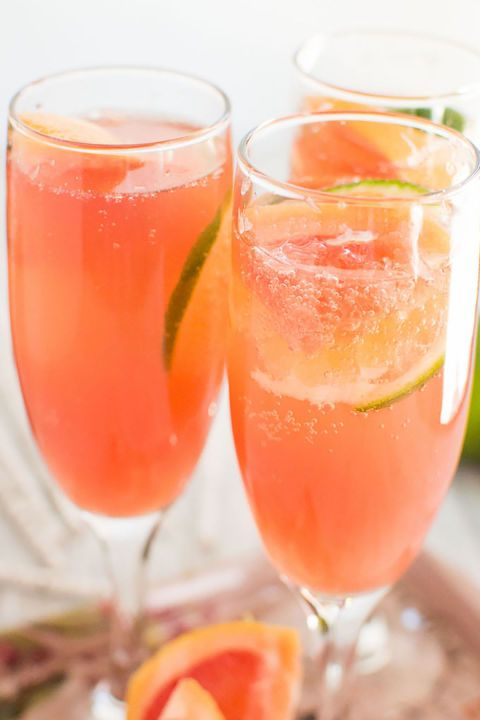 Paloma Mimosas:  A quirky mix of the two classic drinks, this colorful cocktail combines tequila and grapefruit soda with champagne and grenadine, topped with slices of lime.
