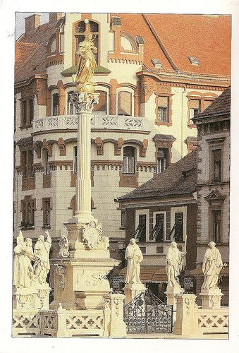 The Virgin's sign-pillar in the main square, by the sculpture J. Straub, 1743.  This is a memorial to all the people in the town who died from plague in the middle ages.  Wonderful buildings in the background.  Thankyou Bubblegum, a wonderful postcard.  Aus x OC 44.