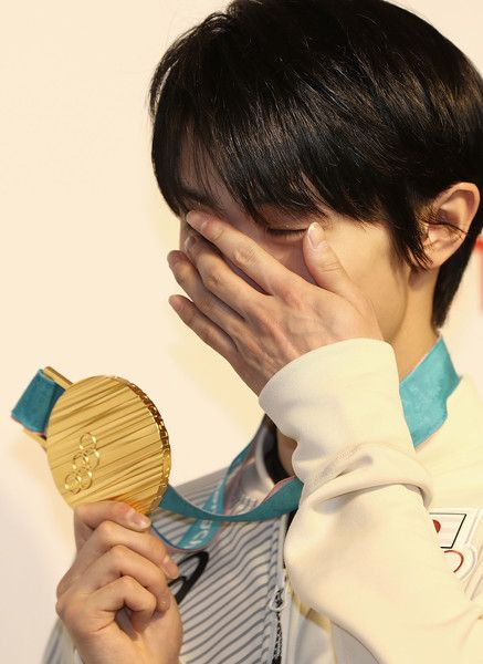 Yuzuru Hanyu Photos - Gold Medalist Figure Skater Yuzuru Hanyu reacts while posing with his medal during a press conference at Japan House on February 18, 2018 in Pyeongchang-gun, South Korea. - Around the Games: Day 9 - Winter Olympic Games