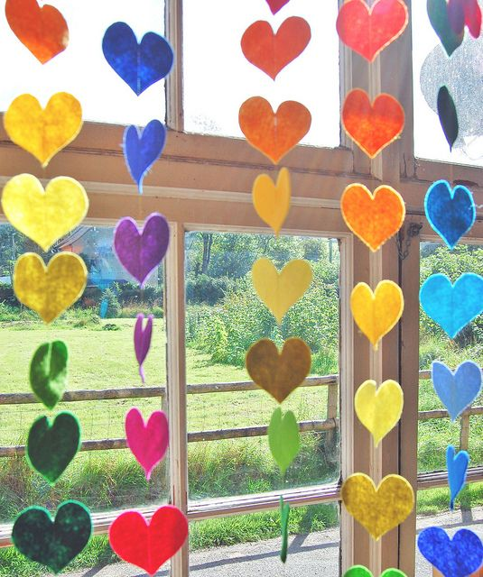 felt rainbow hearts in the windows as a surprise for when they wake up