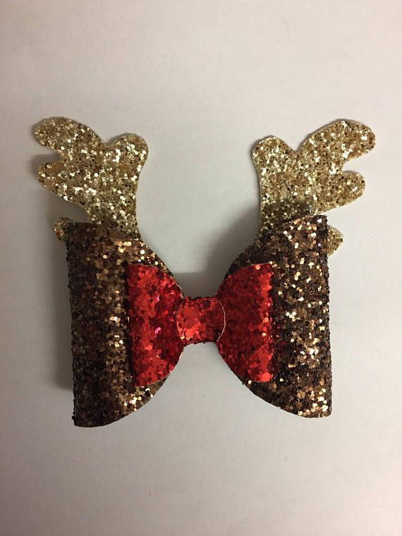 Rudolph the red nose reindeer hair clip. Perfect for adding a fun bit of Christmas into your hairstyle. Available on a clip. Width : 4 inches Height : 4 inches Each of our handmade hair bows are made to order, therefor each of them will be slightly different, giving them a unique