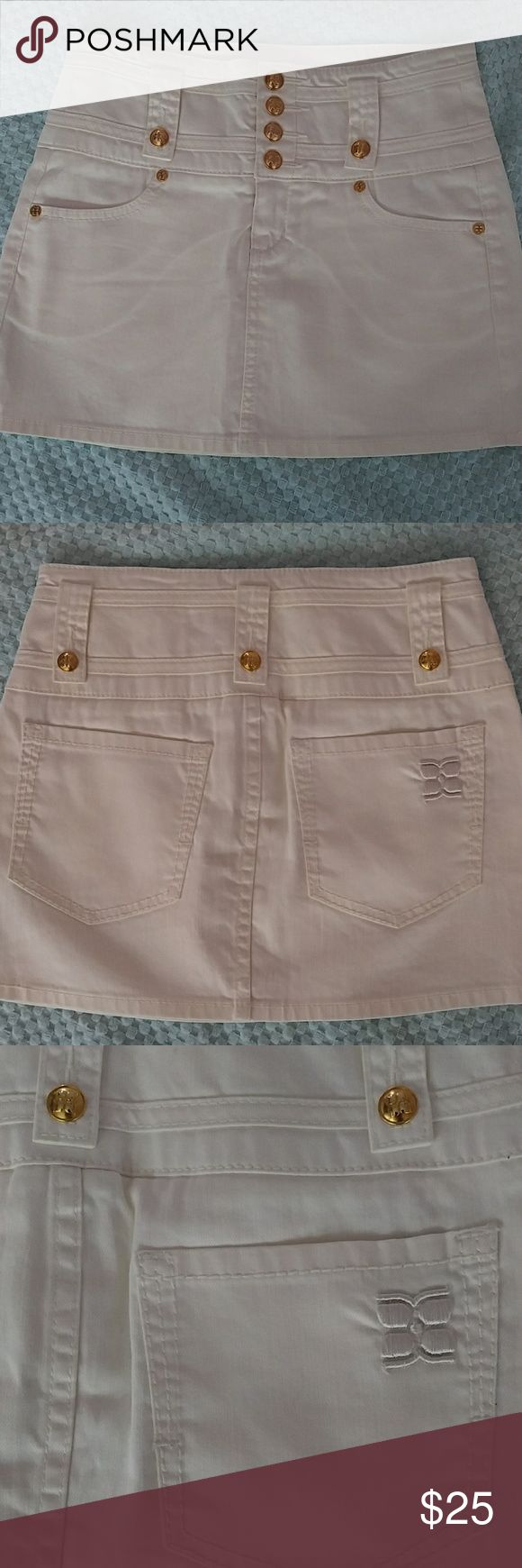 NWOT/ BCBG MAXAZRIA skirt New without tags, never worn, color white denim material, size 25, 98% cotton 2% lycra, gold tone buttons and a front zipper, pockets front and back. In excellent condition. Unfortunately, does not fit. Love the details on buttons.  No trades BCBGMaxAzria Skirts Mini