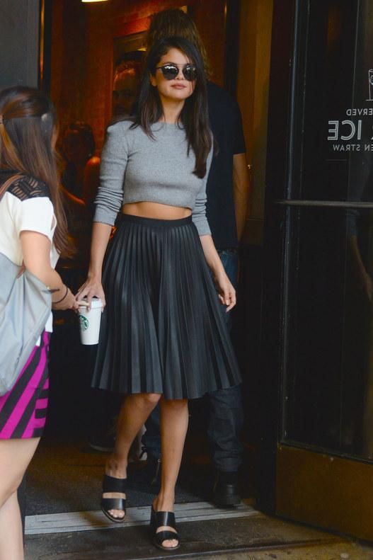 Selena Gomez masters the pleated leather skirt style—here's how to wear it for summer and fall