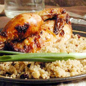 Hamam Mahshi bi Burghul (Cornish Hens with Bulgur, Raisins, and Pine Nuts) | MyRecipes.com