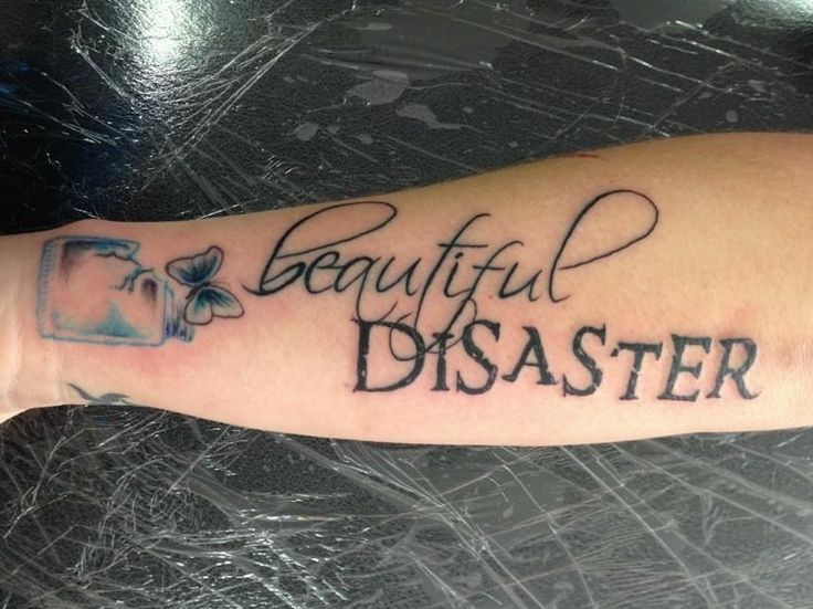 Beautiful Disaster Tattoo With A Small Blue Butterfly