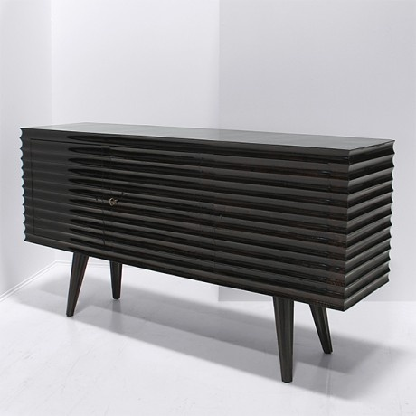 Italian Ribbed Credenza    'Ribbed' Credenza, hand-crafted in Italy c1950s. Constructed from European Oak timber- finished in gloss liquorice lacquer, the credenza features three lockable cupboards with internal shelving. Nicholas & Alistair