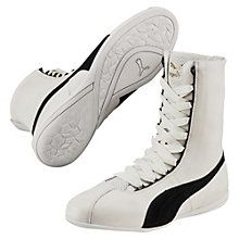 A fearless update of the PUMA Gong – a classic boxing design from the 60s – the Eskiva Hi fuses true sport heritage and high fashion with a contemporary, low-profile look. Crafted in soft leather, it's boldness born in the boxing ring.  Features:   Leather upper with suede overlays  Hi height  Lace closure for a snug fit  Perf detailing at tongue  Heel pull tab for easy on and off  Rubber outsole with tooling that mimics a boxer's hand wrap  Gold foil PUMA Logo at tong...