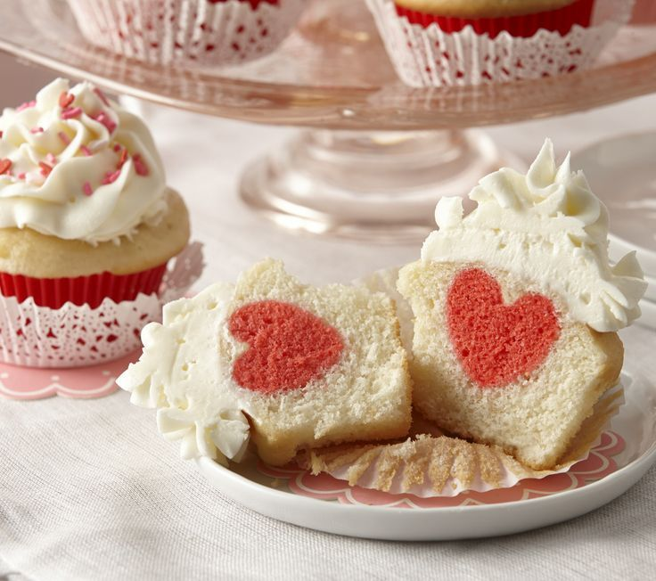 Impress your family with these Valentine's Day vanilla cupcakes that hide a heart-shaped surprise.
