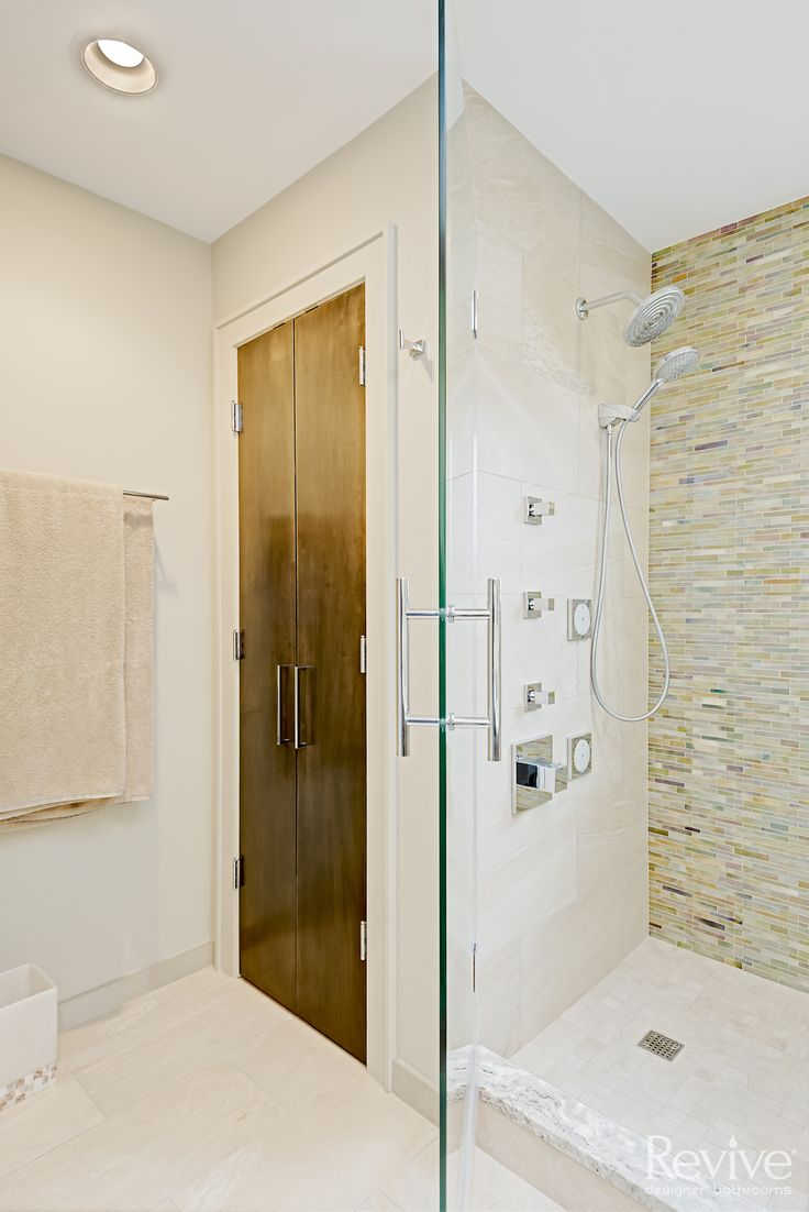 Simple This modern shower has a rain shower head as well as a detachable shower wand