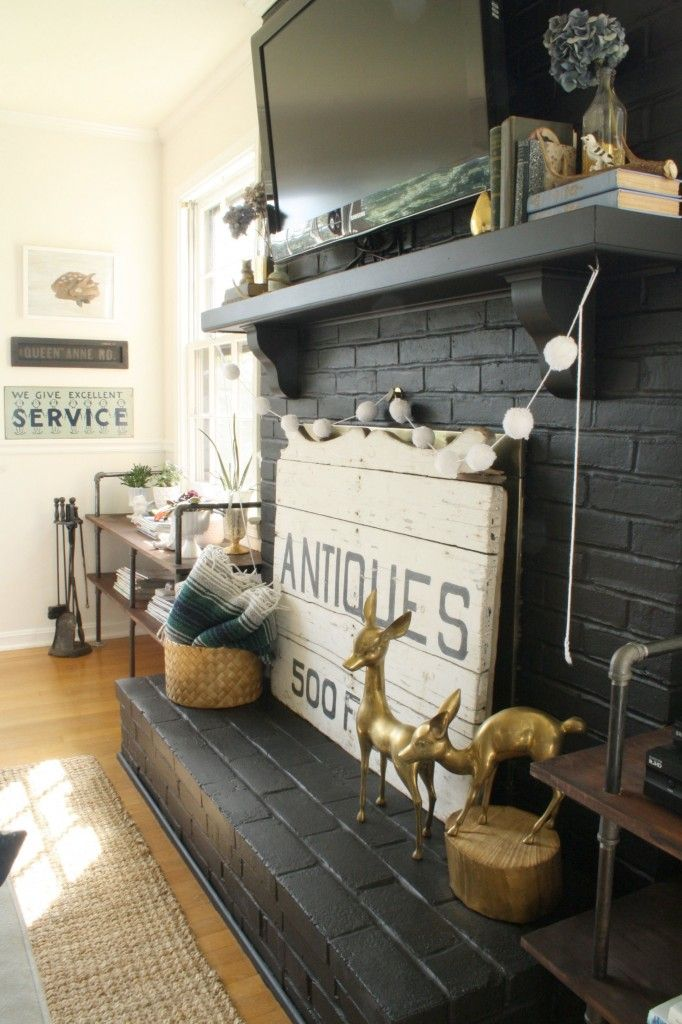 Love this antique sign used as a fireplace screen - her home is gorgeous!
