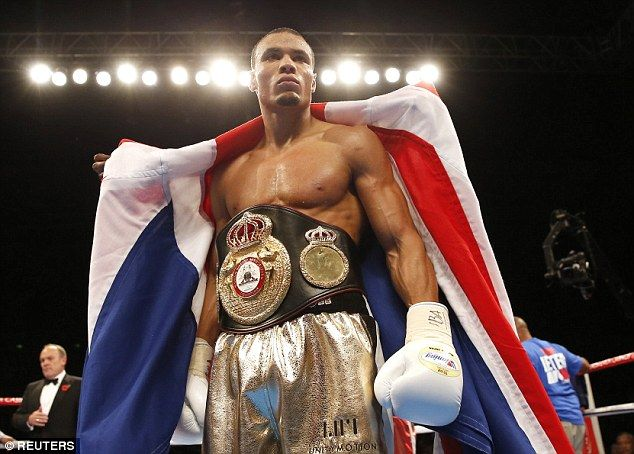 Chris Eubank Jr poses with his belt and the Union Flag after a comfortable victory over Tony Jeter in Sheffield