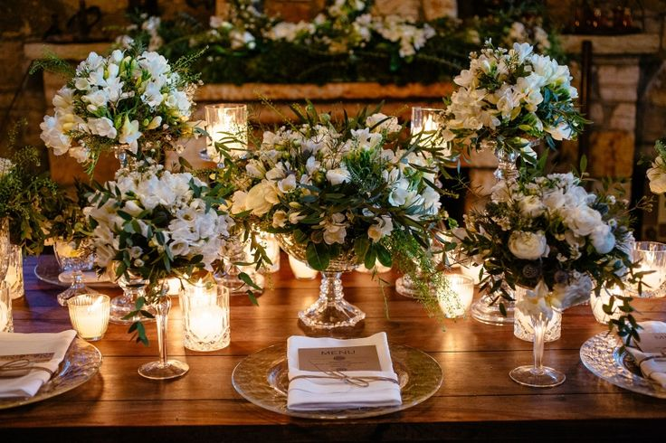Wedding set up with bloomed flower compositions filling up the space elegantly.