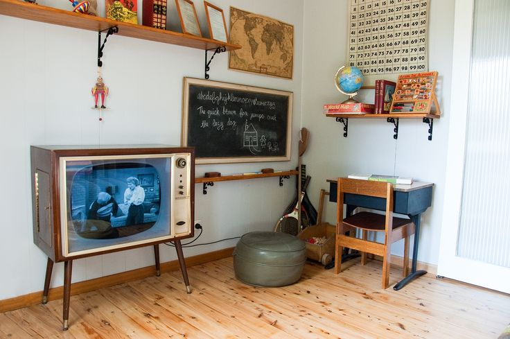 """This is the school room corner of the kids/TV room. The 1950s TV has had all the tubes removed and has a flat screen TV/DVD player inside it - ready to play DVDs of all the old shows like """"I love Lucy""""."""
